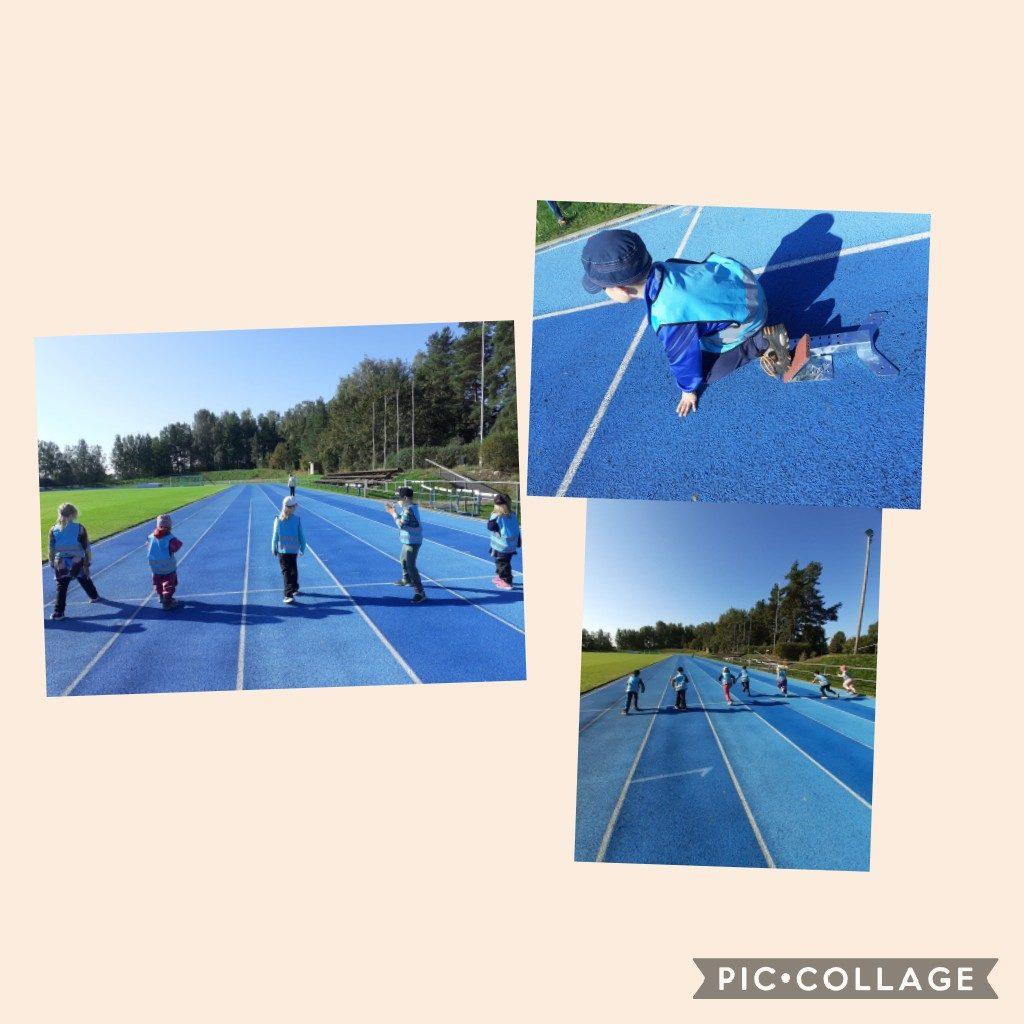 Lapset juoksevat urheilukentän juoksuradalla