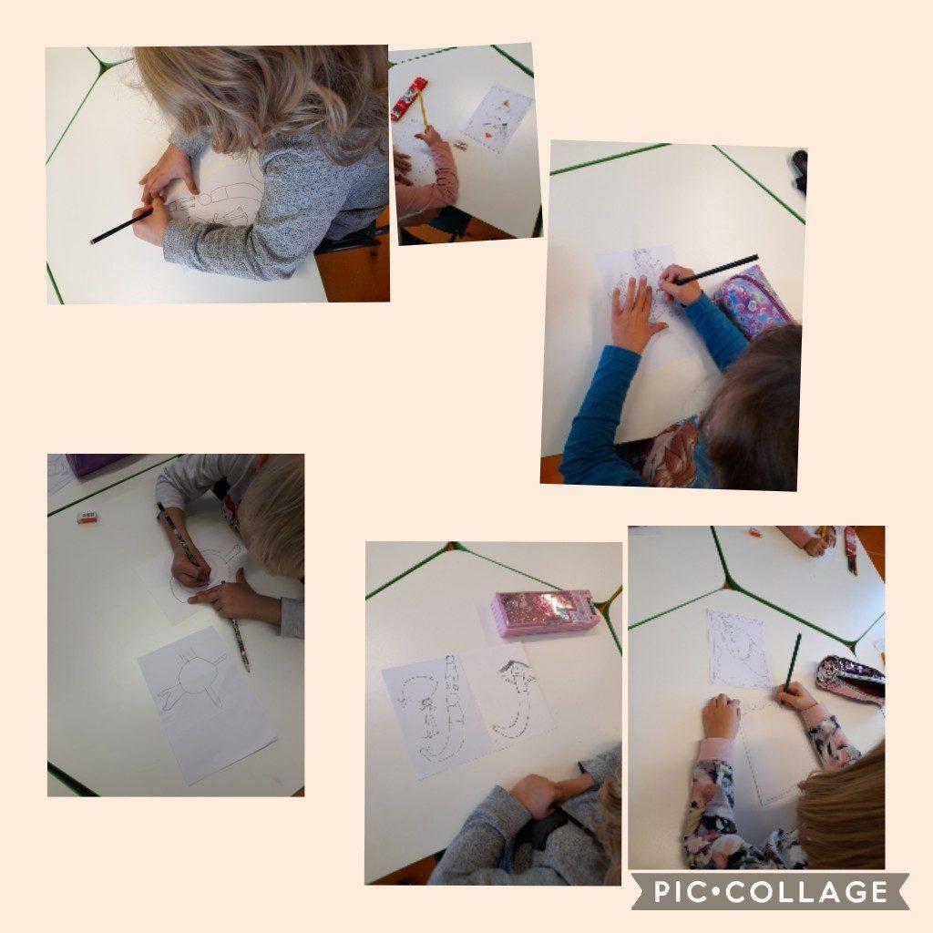 Lapset piirtävät pöydän ääressä