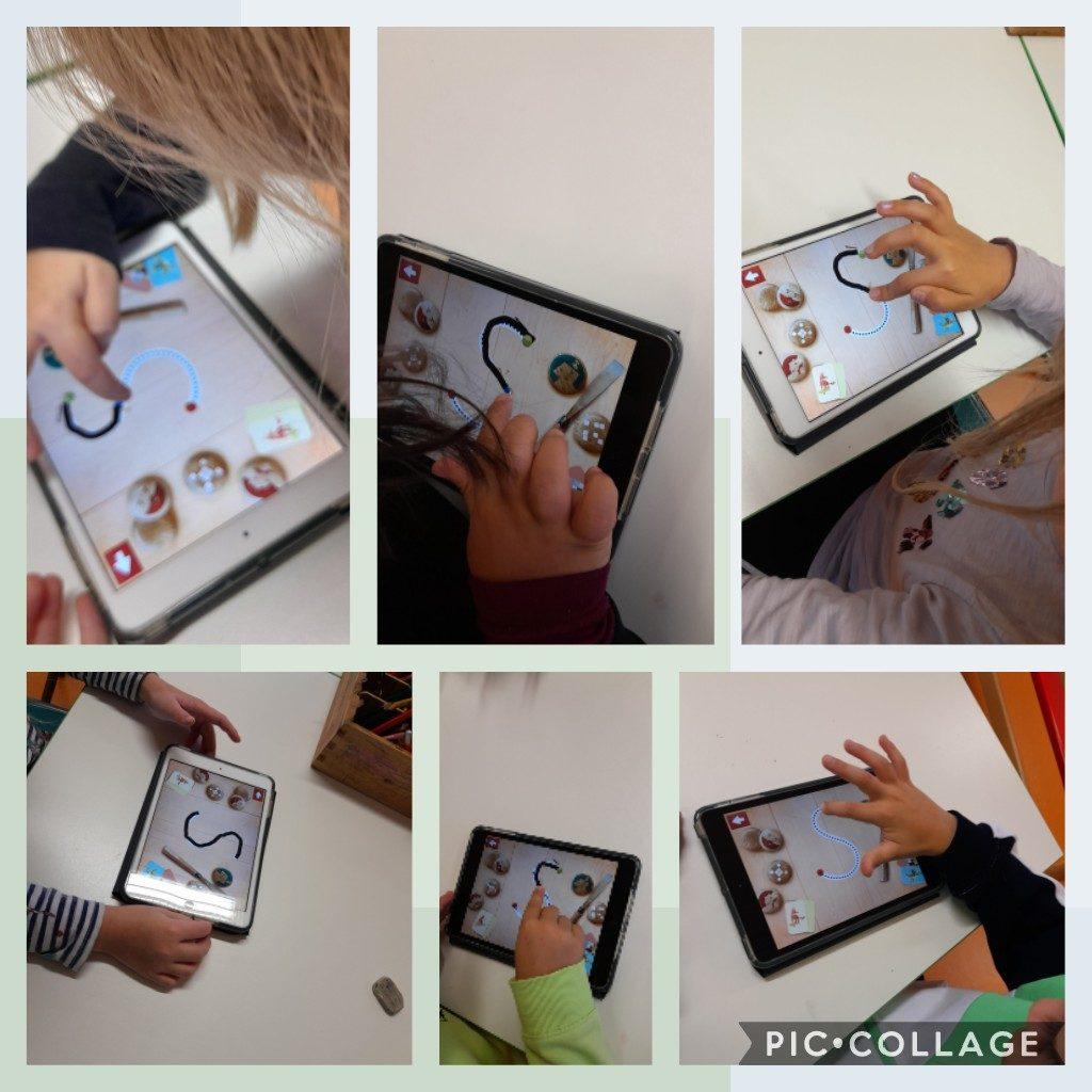 Lapset harjoittelevat tableteilla S-kirjainta