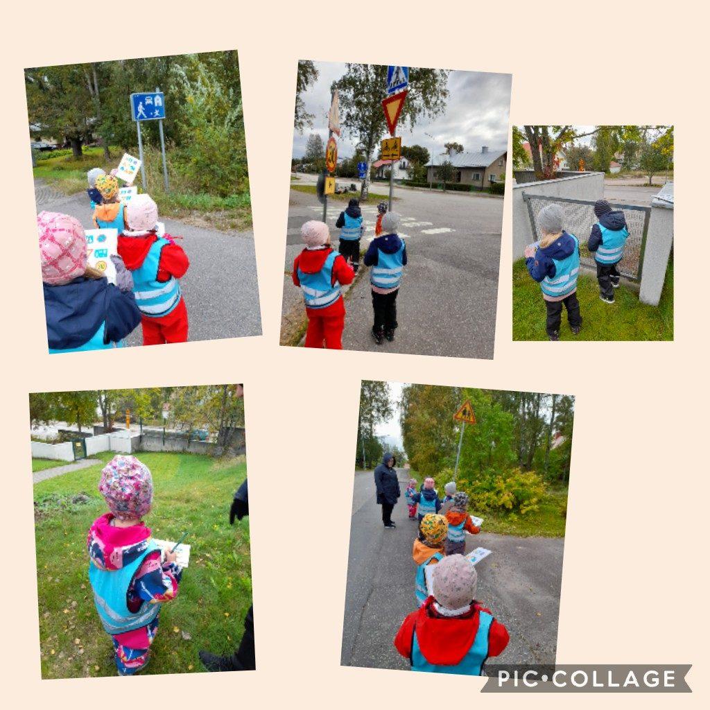 Lapset etsivät liikenteessä liikennemerkkejä