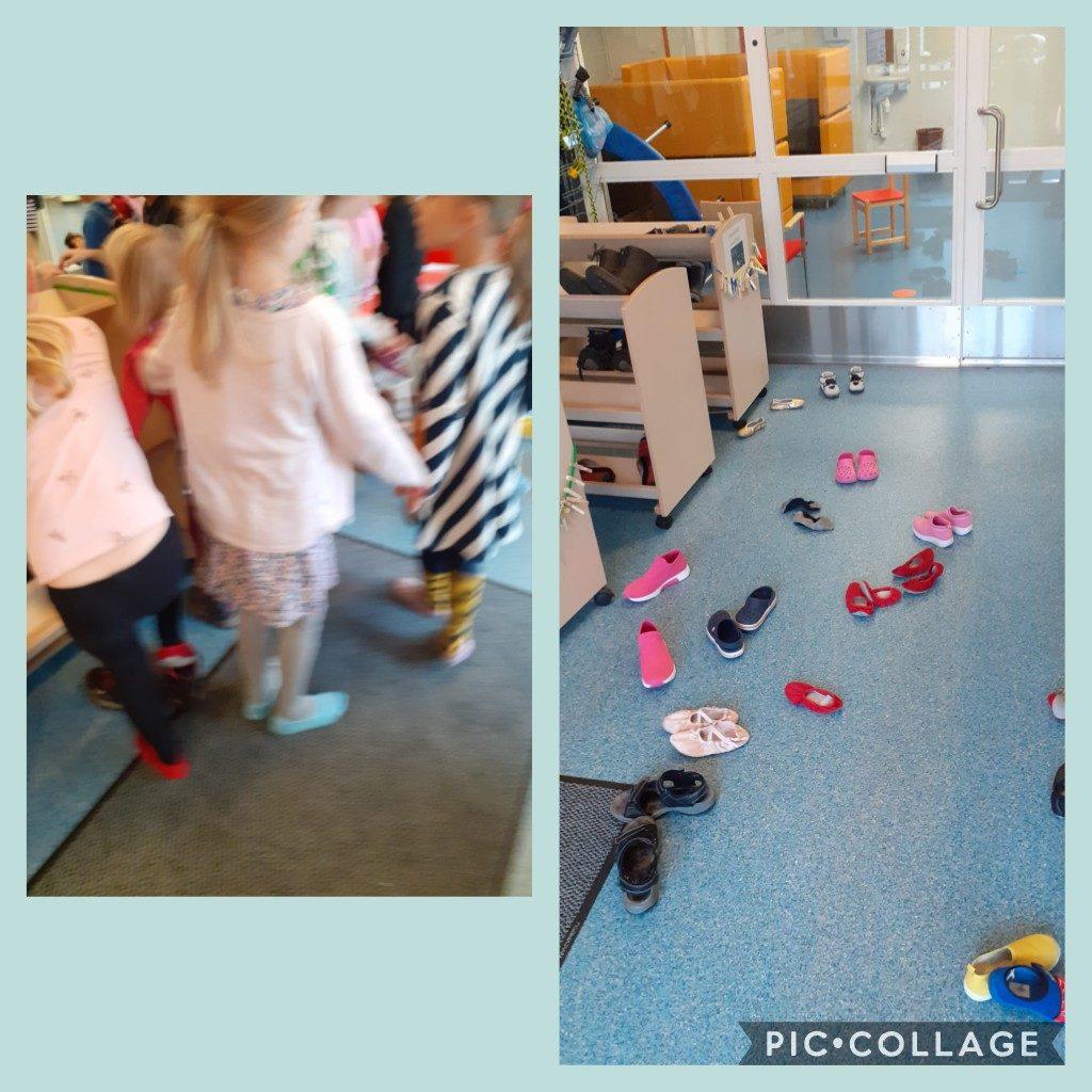 Lapset ovat riisuneet tossut pois jaloistaan ja laittavat kenkiä jalkaan