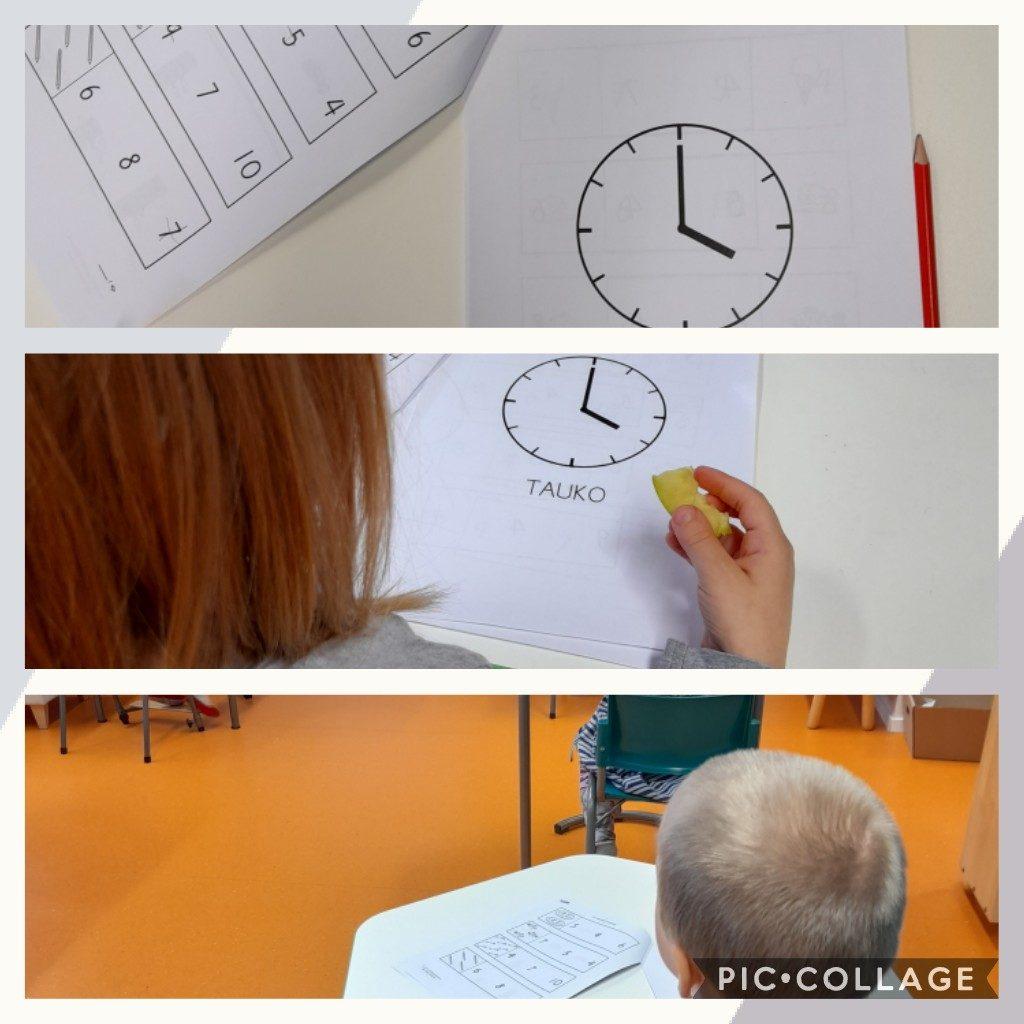 Lapset tekevät matematiikkatehtäviä