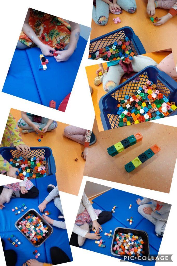 Lapset rakentavat multilink-nappuloista rakennelmia
